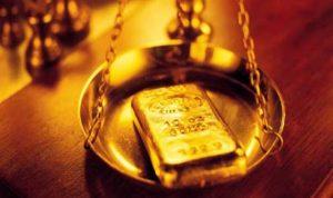 توقُّع تراجُع الذهب 15% الى 900 دولار