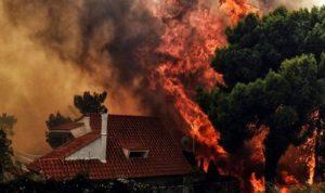 اليونان تحترق وبوتين يعرض المساعدة
