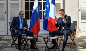 سوريا وليبيا وسليماني في حديث بين بوتين وماكرون