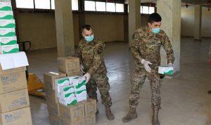 بالصور: تعاون عسكري – مدني لتوزيع مساعدات
