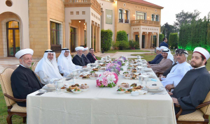 بخاري يقيم مائدة إفطار على شرف دريان