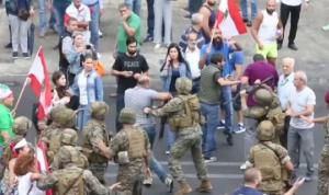 جرحى وإطلاق نار وحجارة في مواجهات بين الجيش والمتظاهرين