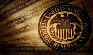 ما هي ردة فعل المصارف المركزية عندما يتوقف الاحتياطي الفيدرالي عن شراء السندات الدولارية؟
